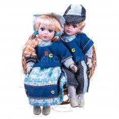Кукла Мальчик и девочка в плетеном кресле 30 см. (в ассорт.)